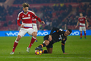 Middlesbrough midfielder Gaston Ramirez (21)  tries to win the ball back from Hull City midfielder Jake Livermore (14) during the Premier League match between Middlesbrough and Hull City at the Riverside Stadium, Middlesbrough, England on 5 December 2016. Photo by Simon Davies.
