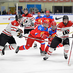 WHITBY, - Dec 14, 2015 -  Game #4 - Russia vs. Canada East at the 2015 World Junior A Challenge at the Iroquois Park Recreation Complex, ON. Players from both teams follow the play during the first period.<br /> (Photo: Shawn Muir / OJHL Images)