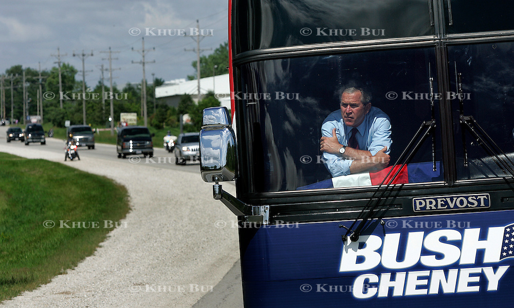 President Bush peers out from the front of his campaign bus 2004...Photo by Khue Bui
