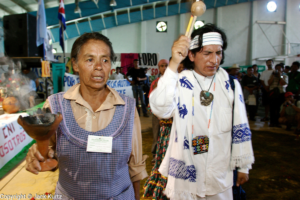 "09 SEPTEMBER 2003 - CANCUN, QUINTANA ROO, MEXICO: A group of indigenous Mexicans perform a blessing ceremony during the opening of the Forum for Indigenous People at the Casa de la Cultura in Cancun during the World Trade Organization Ministerial meetings. The indigenous forum was held as a ""trade fair"" counterpoint to the fair trade talks going on in the Mexican resort city.   PHOTO BY JACK KURTZ"