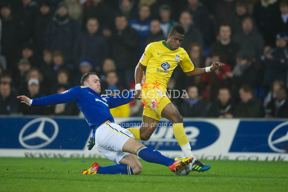 CARDIFF, WALES - Tuesday, January 24, 2012: Cardiff City's Darcy Blake in action against Crystal Palace's Wilfried Zaha during the Football League Cup Semi-Final 2nd Leg at the Cardiff City Stadium. (Pic by David Rawcliffe/Propaganda)