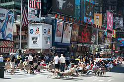 People in chairs in Times Square, New York
