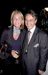 MRS JOHAN ELIASCH and designer TOMASZ STARZEWSKI,<br />  at a party in London on 15th May 2000.OEB 116