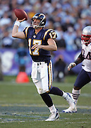 SAN DIEGO - JANUARY 14:  Quarterback Philip Rivers #17 of the San Diego Chargers unloads a pass that gets intercepted by linebacker Rosevelt Colvin of the New England Patriots at the AFC Divisional Playoff Game held on January 14, 2007 at Qualcomm Stadium in San Diego, California. The Patriots defeated the Chargers 24-21. ©Paul Anthony Spinelli *** Local Caption *** Philip Rivers;Rosevelt Colvin