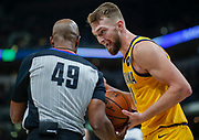 INDIANAPOLIS, IN - NOVEMBER 08: NBA referee Tom Washington #49 listens to Domantas Sabonis #11 of the Indiana Pacers during the game against the Detroit Pistons at Bankers Life Fieldhouse on November 8, 2019 in Indianapolis, Indiana. NOTE TO USER: User expressly acknowledges and agrees that, by downloading and/or using this photograph, user is consenting to the terms and conditions of the Getty Images License Agreement (Photo by Michael Hickey/Getty Images) *** Local Caption *** Tom Washington; Domantas Sabonis