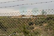 """Caltagirone, Feb. 2016 -   Le parabole del MUOS si trovano fra il territorio di Niscemi e quello di Catagirone, in un quella che dovrebbe essere la Riserva Naturale Orientata, una sughereta.  La base dove sorgono le tre parabole del MUOS è, tuttavia, diventato di fatto territorio americano, presediato dalla Marina Militare Americana e """"protetto"""" dall'Esercito nell'ambito dell'operazione """"Strade Sicure"""", pronti a chiedere generalità e documenti a chiunque si aggiri nei dintorni, soprattutto se attivisti locali."""