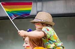 © Licensed to London News Pictures. <br /> 27/09/2014. <br /> <br /> Middlesbrough, United Kingdom<br /> <br /> Frank Smith, 3, from Middlesbrough is carried along during a parade in the centre of Middlesbrough as part of a Pride event that brings together many members of the Lesbian, Gay, Bisexual and Transgender community from the area.<br /> <br /> Photo credit : Ian Forsyth/LNP