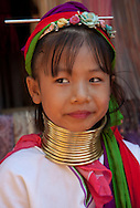 Young Long Neck girl in the near of Chiang Rai, North Thailand.