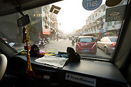 View of traffic through the dirty windshield of a van in Yangshuo, China.