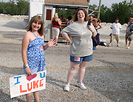 Lindsey Burns, 10 of Sidney (left) gets ready for a meet & greet with Luke Bryan at the 31st annual Country Concert in Fort Loramie, Ohio, Thursday, July 7, 2011.