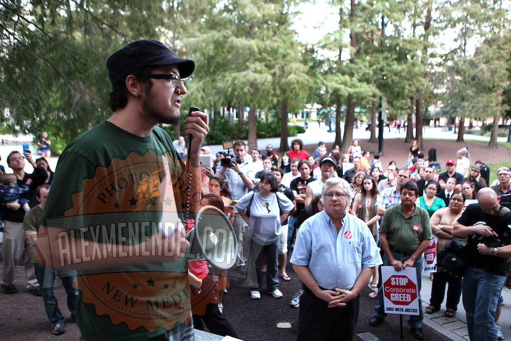 A member speaks during an Occupy Orlando public demonstration in support of Occupy Wall Street gatherings across the country, at the Orange County History Center on Wednesday, October 5, 2011 in Orlando, Florida. (AP Photo/Alex Menendez)