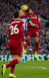 LIVERPOOL, ENGLAND - Saturday, November 30, 2019: Liverpool's Alex Oxlade-Chamberlain (R) challenges for a header with Brighton & Hove Albion's Aaron Mooy during the FA Premier League match between Liverpool FC and Brighton & Hove Albion FC at Anfield. (Pic by David Rawcliffe/Propaganda)