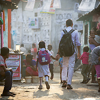 Children on their way to school in Horijon Polli. <br /> <br /> All of the residents of Horijon Polli, a slum in Mymensingh are from the low-caste Hindu sweeper community. The community are ostracised from wider society and there are very few employment opportunities for them beyond cleaning. Oxfam are building a latrine block in Horijon Polli and are working with partners NGO Forum to support residents.<br /> <br /> Photo: Tom Pietrasik<br /> Mymensingh, Bangladesh<br /> November 20th 2014