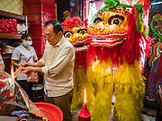 27 JANUARY 2017 - BANGKOK, THAILAND: Chinese Lion dancers perform in a Chinese Shrine in Bangkok on Chinese New Year. 2017 is the Year of the Rooster in the Chinese zodiac. This year's Lunar New Year festivities in Bangkok were toned down because many people are still mourning the death Bhumibol Adulyadej, the Late King of Thailand, who died on Oct 13, 2016. Chinese New Year is widely celebrated in Thailand, because ethnic Chinese are about 15% of the Thai population.      PHOTO BY JACK KURTZ