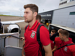 CARDIFF, WALES - Monday, September 4, 2017: Wales' Ben Davies boards the team plane as the squad depart Cardiff Airport to travel to Chișinău ahead of the 2018 FIFA World Cup Qualifying Group D match against Moldova. (Pic by David Rawcliffe/Propaganda)