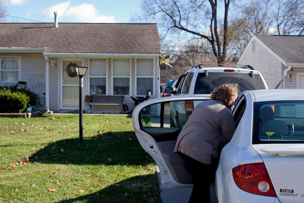 Horizons volunteer coordinator Anna Ronnebaum retrieves a Meals on Wheels lunch from the back of her car at a stop on her route in Cedar Rapids on Thursday, November 19, 2015. The Meals on Wheels program is funded by the federal government through the Older Americans Act, which was passed by congress fifty years ago to support the health and independence of senior Americans. (Rebecca F. Miller/Freelance for The Gazette)