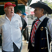 MIAMI, FLORIDA, APRIL 22, 2017<br /> Francisco Perez, left 75,  chats with Eutimio A. Diaz, 69,  in Miami's Little Havana neighborhood's Maximo Gomez Domino Park. Many Miami Cubans voted for Donald Trump in the general elections. Trump will soon complete his first 100 days as United States President.<br /> (Photo by Angel Valentin/Freelance)