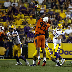 Sep 23, 2017; Baton Rouge, LA, USA; LSU Tigers quarterback Myles Brennan (15) throws past Syracuse Orange defensive lineman Chris Slayton (95) during the fourth quarter of a game at Tiger Stadium. LSU defeated Syracuse 35-26. Mandatory Credit: Derick E. Hingle-USA TODAY Sports