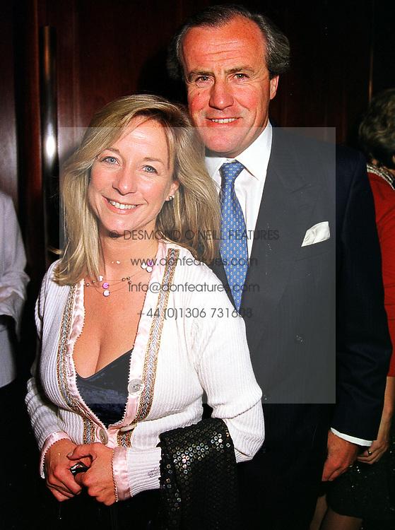 MR & MRS JUSTIN CADBURY at a reception in London on 14th October 1999.<br /> MXT 26