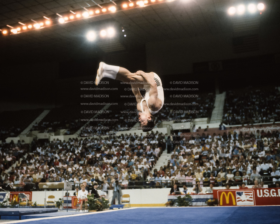 PHOENIX - APRIL 24:  Dimitri Belozerchev of the USSR competes in the floor exercise during a USA - USSR gymnastics meet on April 24, 1988  at the Arizona Veterans Memorial Coliseum in Phoenix, Arizona.  (Photo by David Madison/Getty Images)