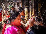 05 MARCH 2017 - KATHMANDU, NEPAL: A woman prays at Seto Machindranath Temple, a 12th century Buddhist temple in Kathmandu.     PHOTO BY JACK KURTZ