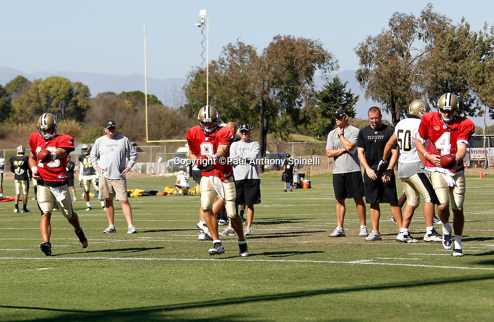 New Orleans Saints quarterback Drew Brees (9) and his backup quarterbacks run drills during the Saints west coast NFL training camp on Wednesday, August 24, 2011 in Oxnard, California. (©Paul Anthony Spinelli)