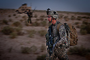 Soldiers walk together at dawn during the first day of Operation Dragon Strike.