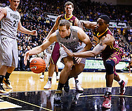 WEST LAFAYETTE, IN - MARCH 09: Sandi Marcius #55 of the Purdue Boilermakers and Andre Ingram #30 of the Minnesota Golden Gophers battle for a loose ball at Mackey Arena on March 9, 2013 in West Lafayette, Indiana.  (Photo by Michael Hickey/Getty Images) *** Local Caption *** Sandi Marcius; Andre Ingram