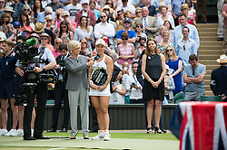 LONDON, ENGLAND - Saturday, July 9, 2016:  Angelique Kerber (GER) is being interviewed by Sue Barker after receiving her trophy for runner up after the Ladies' Singles - Final match on day thirteen of the Wimbledon Lawn Tennis Championships at the All England Lawn Tennis and Croquet Club. (Pic by Kirsten Holst/Propaganda)