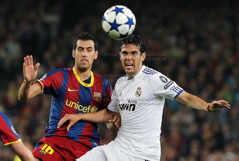 03-05-2011 VOETBAL: SEMI FINAL CL  FC BARCELONA - REAL MADRID: BARCELONA<br />  Sergio Busquets (l) and Kaka <br /> *** NETHERLANDS ONLY***<br /> &copy;2011-FH.nl- EXPA/ Alterphotos/ Acero