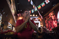 July 1, 2018 - Miami Beach, FL, USA - Juan Carlos Muniz, 49, watches a soccer match at Tapas and Tintos, a restaurant in Miami Beach, Fla. where fans gathered to watch Spain take on Russia during the 2018 FIFA World Cup Round of 16 knockout stage on Sunday, July 1, 2018. After the score being tied 1-1 at the end of extra time, Russia won, 4 penalty kicks to 3. (Credit Image: © Ellis Rua/TNS via ZUMA Wire)