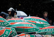 Supporters's umbrellas on the main tribune while Day Fifth during The French Open 2013 at Roland Garros Tennis Club in Paris, France.<br /> <br /> France, Paris, May 30, 2013<br /> <br /> Picture also available in RAW (NEF) or TIFF format on special request.<br /> <br /> For editorial use only. Any commercial or promotional use requires permission.<br /> <br /> Mandatory credit:<br /> Photo by © Adam Nurkiewicz / Mediasport