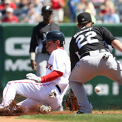 March 12, 2011; Fort Myers, FL, USA; Boston Red Sox left fielder Jacoby Ellsbury (2) slides past Florida Marlins shortstop Donnie Murphy (22) during a spring training exhibition game at City of Palms Park. The Red Sox defeated the Marlins 9-2.  Mandatory Credit: Derick E. Hingle
