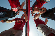 CAMPER with Emirates Team New Zealand hoisting the Main. Volvo Ocean Race stopover in in Abu Dhabi, United Arab Emirates. 9/1/2012
