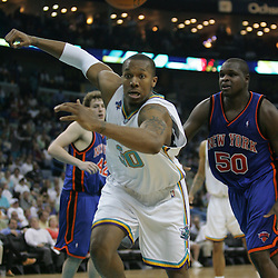 David West #30 of the New Orleans Hornets scrambles for a loose ball against the New York Knicks  in the third quarter of their NBA game on April 4, 2008 at the New Orleans Arena in New Orleans, Louisiana. New Orleans Hornets defeated the New York Knicks 118-110 and with the win clinched a NBA Playoff birth.