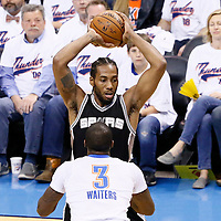 06 May 2016: San Antonio Spurs forward Kawhi Leonard (2) looks to pass the ball over Oklahoma City Thunder guard Dion Waiters (3) during the San Antonio Spurs 100-96 victory over the Oklahoma City Thunder, during Game Three of the Western Conference Semifinals of the NBA Playoffs at the Chesapeake Energy Arena, Oklahoma City, Oklahoma, USA.