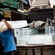 Delivering ice to Binh Tay Market, Saigon, Vietnam.