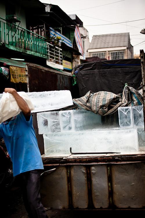 Delivering ice to Binh Tay Market, Saigon, Vietnam.