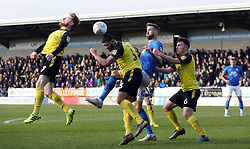 Mark Beevers of Peterborough United challenges for the ball with Stephen Quinn, Colin Daniel and Kieran Wallace of Burton Albion - Mandatory by-line: Joe Dent/JMP - 29/02/2020 - FOOTBALL - Pirelli Stadium - Burton upon Trent, England - Burton Albion v Peterborough United - Sky Bet League One