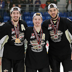 TRENTON, ON  - MAY 6,  2017: Canadian Junior Hockey League, Central Canadian Jr. &quot;A&quot; Championship. The Dudley Hewitt Cup Championship Game between The Trenton Golden Hawks and The Georgetown Raiders. Jeremy Pullara #21, Louis DiMatteo #20 and Anthony Sorrentino #77 of the Trenton Golden Hawks during post game celebrations. <br /> (Photo by Amy Deroche / OJHL Images)