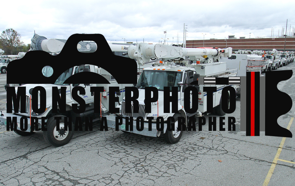 A fleet of 140 Florida Power & Light Company truck wait in line Wednesday, Oct. 31, 2012, in Wilmington DE.  ..DPL Staging Area is an Operations Center for the Mutual Assistance Crews coming from the surrounding states to support restoration efforts.