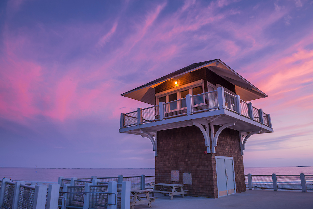 Life-saving station & pink sky at dusk, Captain Roger W Wheeler Beach and ocean views, Point Judith, Narragansett, RI