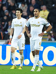 SWANSEA, WALES - Saturday, December 8, 2012: Swansea City's captain Ashley Williams and Ki Sung-Yeung look dejected as Norwich City score the opening goal during the Premiership match at the Liberty Stadium. (Pic by David Rawcliffe/Propaganda)