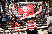 TUNIS, TUNISIA - 26 JULY 2013: An anti-government activist shows a pictures with both the Tunisian and Egyptian flag as he demands the same model for the Tunisian Republic, in front of the National Constituent Assemby (NCA)  in Tunis, Tunisia, on July 26th 2013.<br /> <br /> Tunisia, birthplace of the Arab Spring revolutionary movement, was plunged into a new political crisis on Thursday when assassins shot Mohamed Brahmi, 58, leader of the Arab nationalist People's Party, an opposition party leader outside his home in a hail of gunfire.