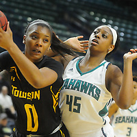 Towson's LaTorri Hines-Allen secures a rebound from UNCW's Ryan Flowers Sunday January 25, 2015 at Trask Coliseum. (Jason A. Frizzelle)