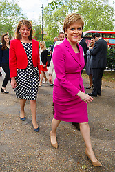 © Licensed to London News Pictures. 23/05/2016. London, UK. Plaid Cymru leader Leanne Wood and Scottish First Minister and Leader of the SNP Nicola Sturgeon arriving at Emmeline Pankhurst memorial statue for a photocall in Victoria Tower Gardens, London on Monday, 23 May 2016 as they make the progressive case in favour of a Remain vote in next month's EU Referendum. Photo credit: Tolga Akmen/LNP