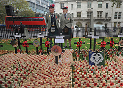 © Licensed to London News Pictures. 10/11/2011. London, UK. A couple of Black Watch Soldiers stands behind crosses.  HRH The duke of Edinburgh opens the annual Field of Remembrance at Westminster Abbey today 10 November. . Photo credit : Stephen Simpson/LNP