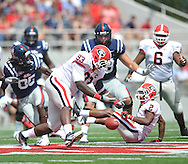 Georgia defensive end Abry Jones (93) attempts unsuccessfully to intercept a pass thrown to Ole Miss' Ja-Mes Logan (85) at Vaught-Hemingway Stadium in Oxford, Miss. on Saturday, September 24, 2011. Georgia won 27-13.
