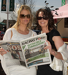 LIVERPOOL, ENGLAND - Thursday, April 8, 2010: Gemma Hussey (L) and Laura Chadburn from Ormskirk check the form in the Racing Post during the opening day of the Grand National Festival at Aintree Racecourse. (Pic by David Rawcliffe/Propaganda)