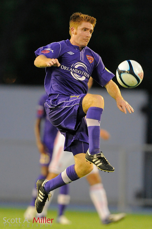 Orlando City Lions midfielder James O'Connor (17) goes airborne for a ball during the Lions 1-0 loss to Stoke City at the Florida Citrus Bowl on July 28, 2012 in Orlando, Florida. ..© 2012 Scott A. Miller.